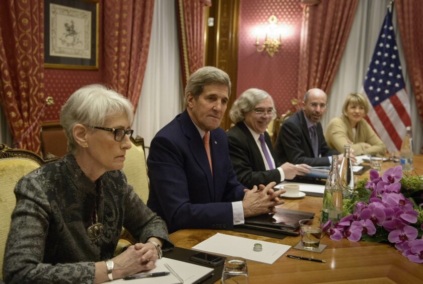 Negotiations over Iran's nuclear program picked up pace on Saturday with the foreign ministers of France and Germany joining U.S. Secretary of State John Kerry in talks with Iran's top diplomat ahead of a looming end-of-March deadline for a preliminary deal. (AP Photo/Brendan Smialowski, Pool)