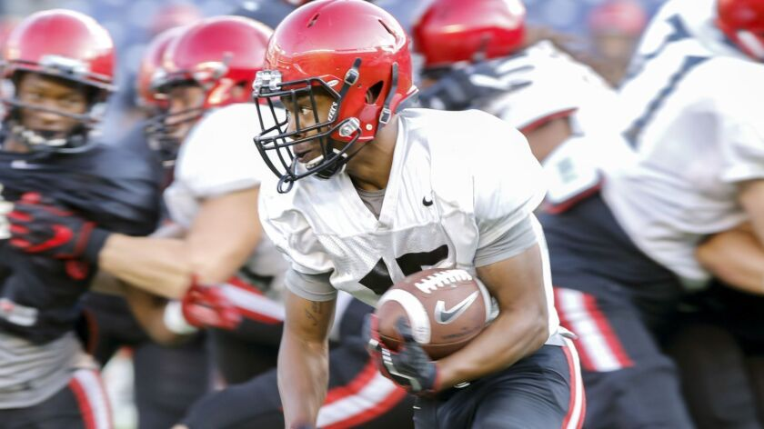 San Diego State Aztec's running back Jordan Byrd turns the corner in this first half run during the
