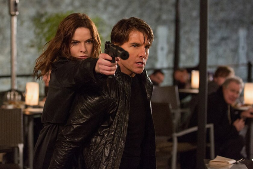"""Rebecca Ferguson and Tom Cruise in """"Mission: Impossible -- Rogue Nation."""""""