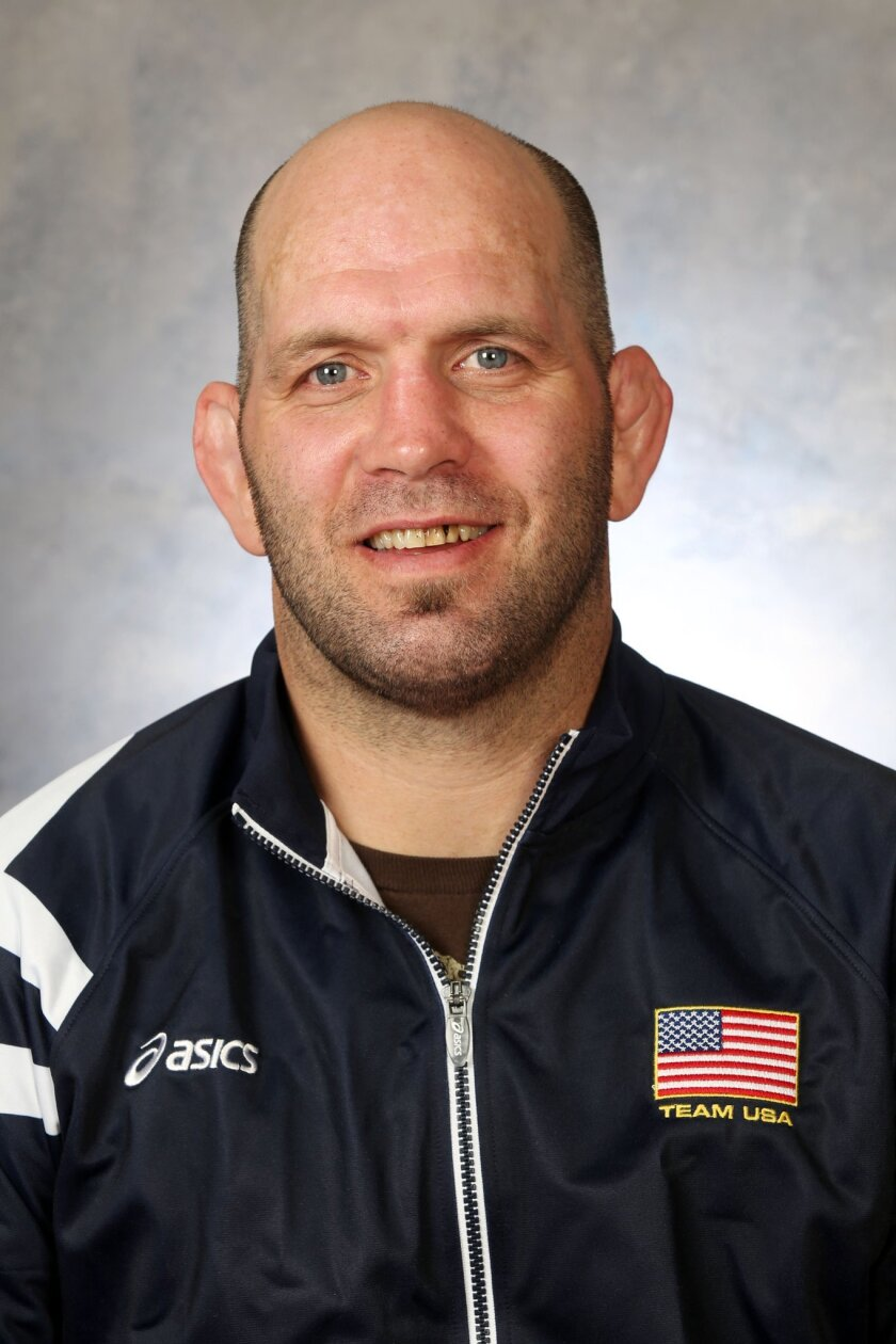 This 2013 photo provided by USA Wrestling shows Matt Lindall who became the first new U.S. coach in nearly two decades this spring. There's hardly a sport in the world with a duller reputation than Greco-Roman wrestling. Lindland, an Olympic silver medalist and retired mixed martial arts fighter, is charged with bringing fresh energy to a program that had grown so stale that it finished without a medal at the Olympics in 2012 for the first time in 36 years. (AP Photo/USA Wrestling)
