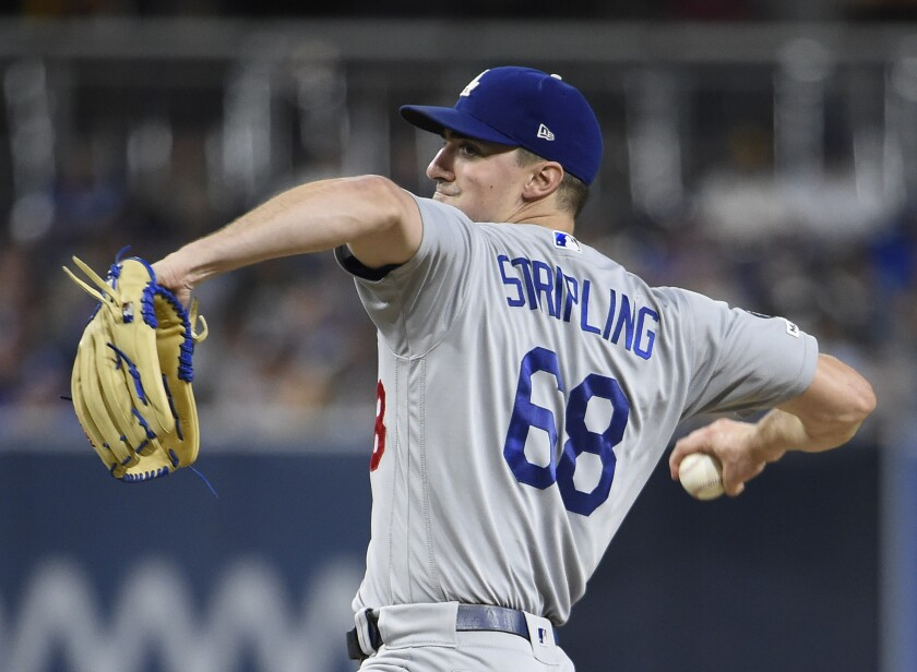 odgers starter Ross Stripling delivers during the first inning against the San Diego Padres.