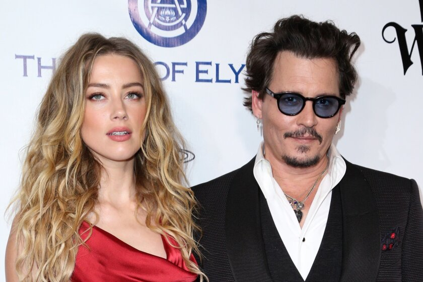 FILE - In this Jan. 9, 2016 file photo, Amber Heard, left, and Johnny Depp arrive at The Art of Elysium's Ninth annual Heaven Gala at 3LABS, in Culver City, Calif.  Heard was in Los Angeles Superior Court court on Friday, May 27, 2016, and provided a sworn declaration that her husband Johnny Depp t