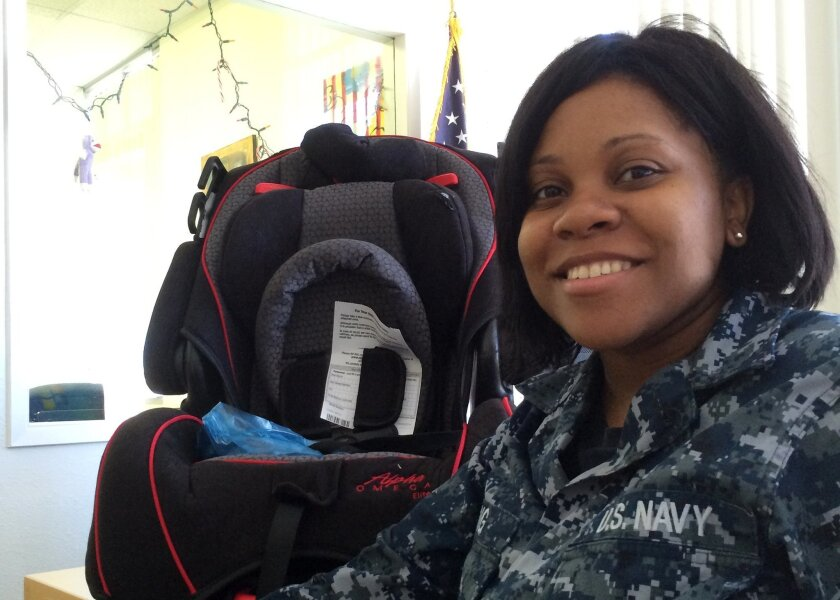 Below, Tony Teravainen, CEO and president of STEP. Above: A pregnant active-duty sailor receives STEP's gift of a baby car seat. Courtesy photo