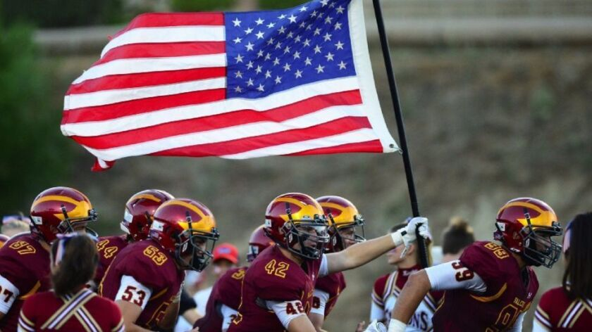 """Torrey Pines High School honored the lives lost on 9/11 and the country's heroes with a """"Salute to America"""" before the Falcons varsity football game against Fallbrook on Sept. 9."""