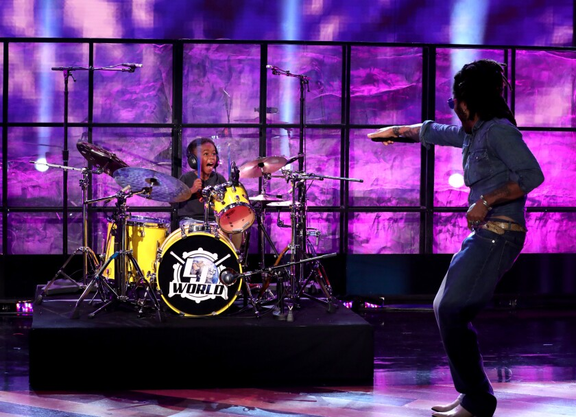 "5-year-old Justin Wilson II, at a set of drums, reacts to meeting Lenny Kravitz on ""The Ellen DeGeneres Show."""