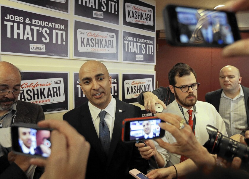 GOP gubernatorial candidate Neel Kashkari, second from left, speaks with reporters at the California Republican Party 2014 Spring Convention.