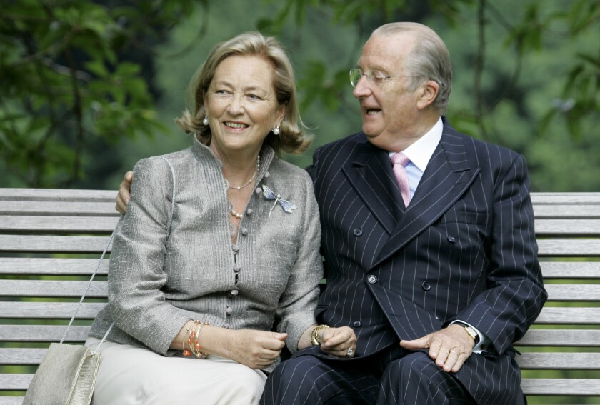 FILE - In this Tuesday, July 17, 2008 file photo, Belgium's Queen Paola and King Albert II pose for photographers at the Royal Palace in Laeken, Belgium. Artist and sculptor Delphine Boel is on the cusp of officially becoming a Belgian princess after a Brussels court on Thursday, Oct. 1, 2020 ruled in her favor in a decades-old royal paternity scandal pitting her against former King Albert II. (AP PhotoVirginia Mayo, File)