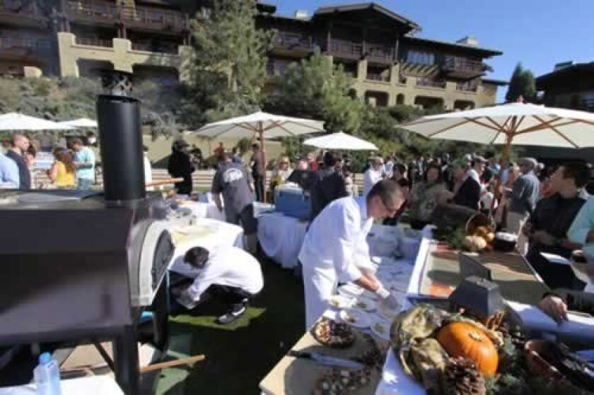 crowds gather at The lodge at Torrey Pines as chefs dish out small bites that pair with tastes of different beers. Daniel Solomon