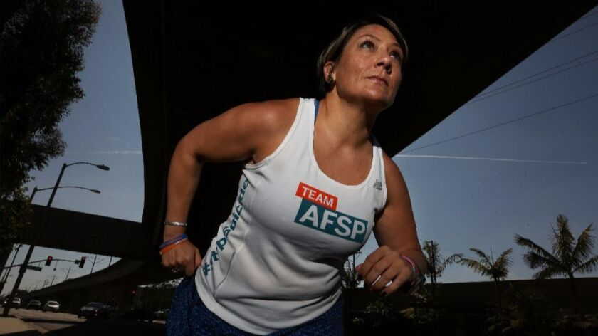 Amy Robinson will run in the L.A. Marathon on Sunday, the eighth marathon in which she's competed in the last three years. Robinson has used running to help combat depression.