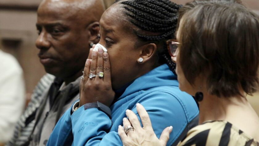 FILE - In this Friday Nov. 3, 2017 file photo, Katrina Johnson becomes emotional at the South Lee Co