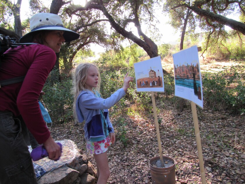 Poway residents Lisa Gymer and her daughter, Ava, 7, check out the storybook hike at Crestridge Ecological Reserve in Crest.