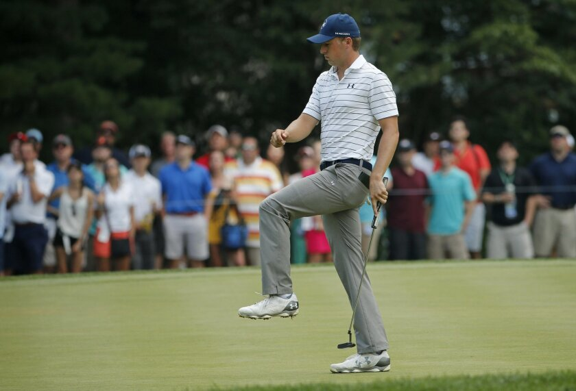 Jordan Spieth reacts to missing a putt on the first hole during the third round of the PGA Championship golf tournament at Baltusrol Golf Club in Springfield, N.J., Saturday, July 30, 2016. (AP Photo/Mike Groll)