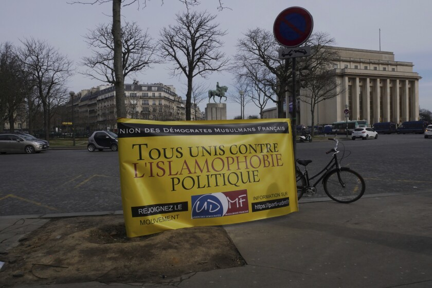 "A banner at a rally Sunday in Paris reads ""All united against political Islamophobia."""