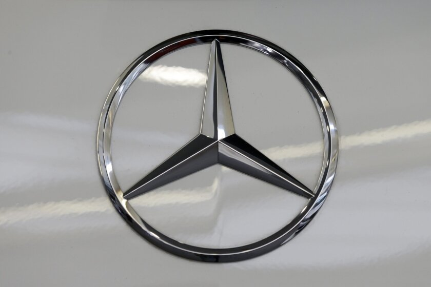 FILE - This Feb. 14, 2013, file photo, shows a Mercedes logo on a Mercedes automobile at the Pittsburgh Auto Show in Pittsburgh.  Mercedes said Wednesday, Nov. 4, 2015, it is recalling more than 126,000 cars and SUVs in the U.S. to fix a problem that can cause the air bags to inflate without a cras