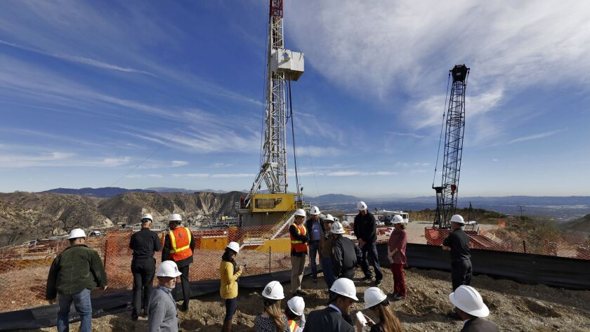Officials tour the drill site of a relief well to stem the methane leak at the Aliso Canyon gas storage facility in 2015.