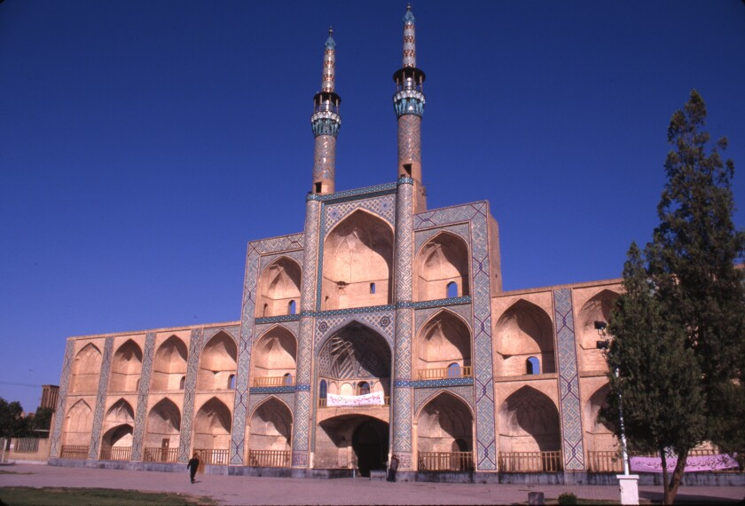 Twin minarets rise above the unusual three-story facade of the Amir Chakhmaq Mosque in Yazd, Iran.