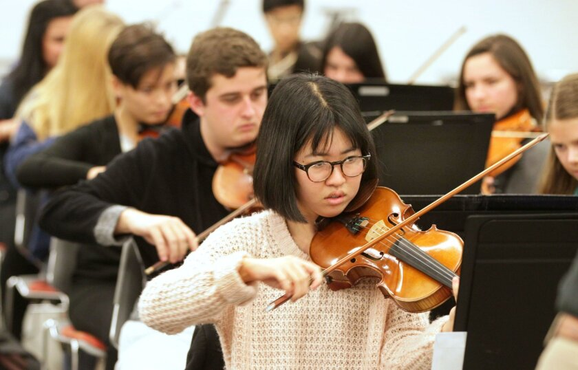 January 9, 2016_Escondido, California_USA_  Violinist Emily Kimura plays during rehearsal for the San Diego Civic Youth Orchestra at Classical Academy High School in Escondido.  _Mandatory Photo Credit: Photo by Charlie Neuman/San Diego Union-Tribune/©2016 San Diego Union-Tribune, LLC