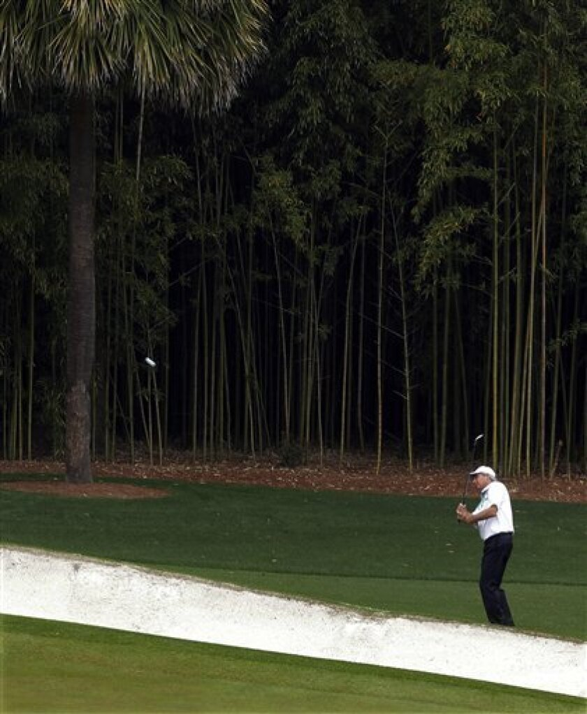Fred Couples chips to the fourth green during the second round of the Masters golf tournament Friday, April 12, 2013, in Augusta, Ga. (AP Photo/Charlie Riedel)