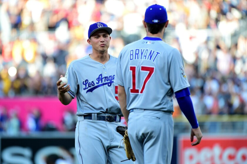Dodgers shortstop Corey Seager, 22, talks to Cubs third baseman Kris Bryant, 24, during Tuesday's MLB All-Star Game.