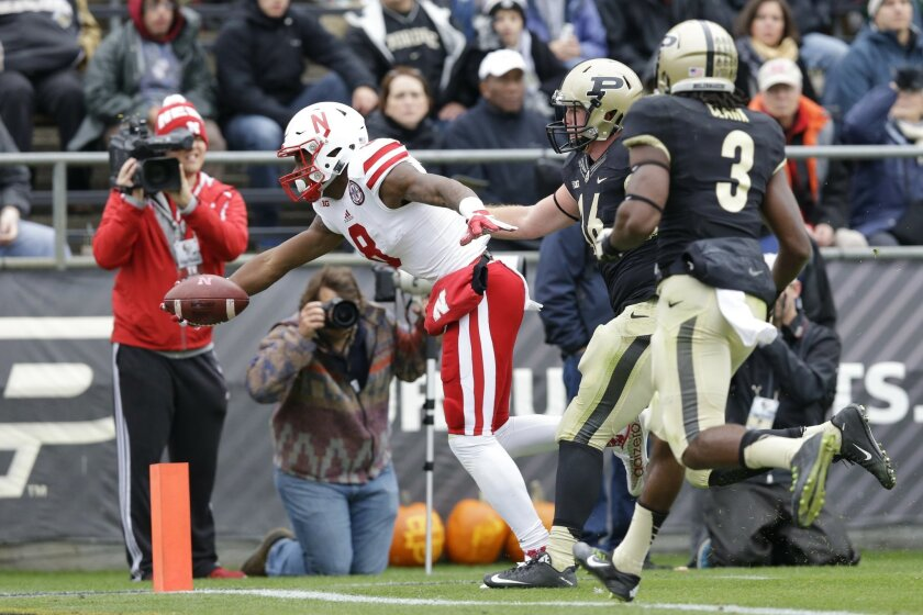 Nebraska wide receiver Stanley Morgan Jr. (8) reaches in for a touchdown in front of Purdue linebacker Garrett Hudson (16) and safety Leroy Clark (3) during the first half of an NCAA college football game in West Lafayette, Ind., Saturday, Oct. 31, 2015. (AP Photo/Michael Conroy)