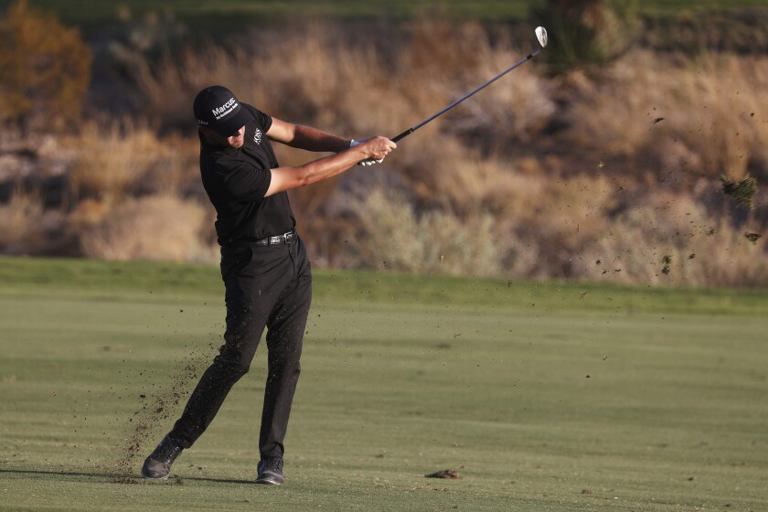 Patrick Cantlay hits a fairway shot at the 18th hole during the third round of the Shriners Hospitals for Children Open golf tournament in Las Vegas, Saturday, Oct. 10, 2020. (Erik Verduzco/Las Vegas Review-Journal via AP)