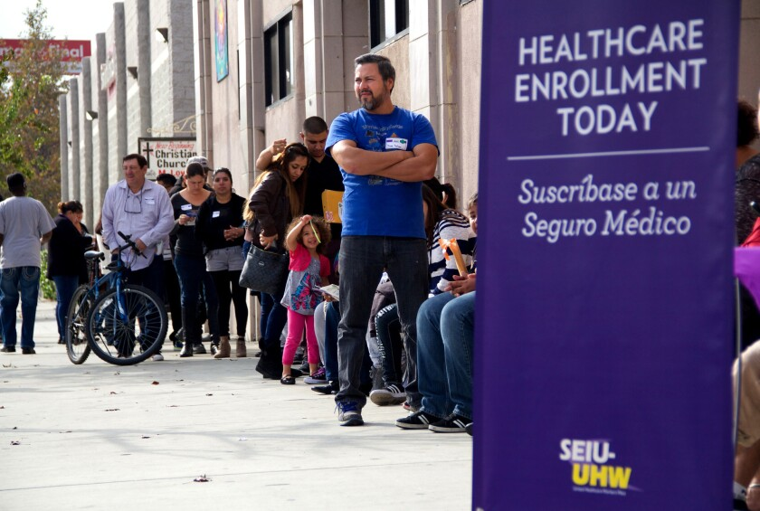 People wait to enter an Affordable Care Act enrollment event sponsored by SEIU-United Healthcare Workers West and Community Coalition, in Los Angeles on Saturday, Nov. 15, 2014.