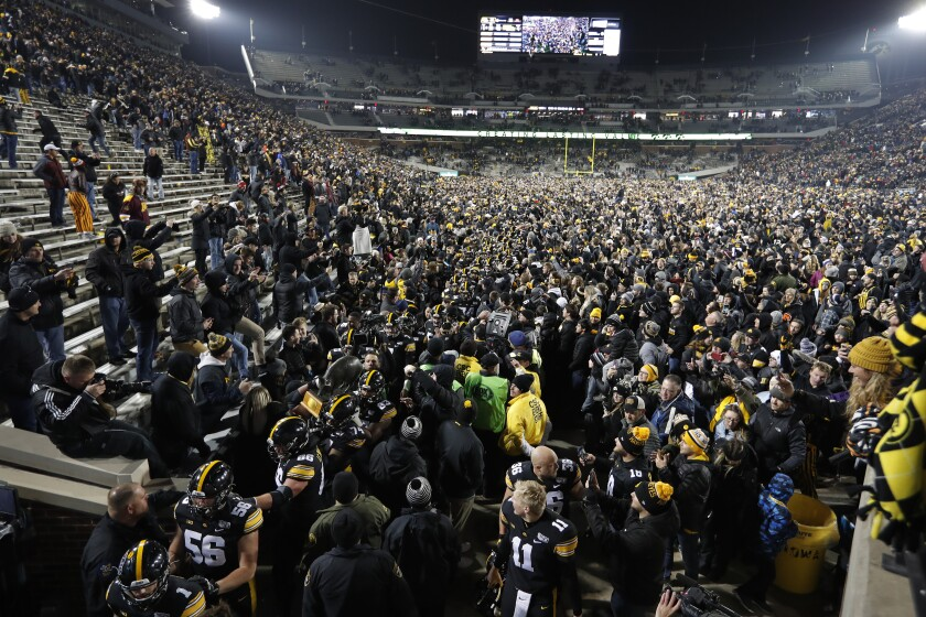 Iowa carries off the Floyd of Rosedale Trophy after defeating Minnesota on Saturday.