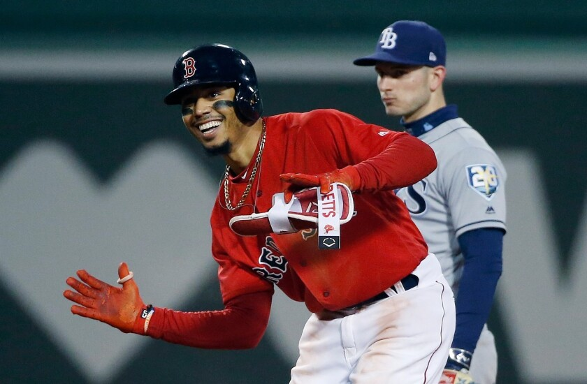 Mookie Betts celebrates a double against the Tampa Bay Rays in 2018.