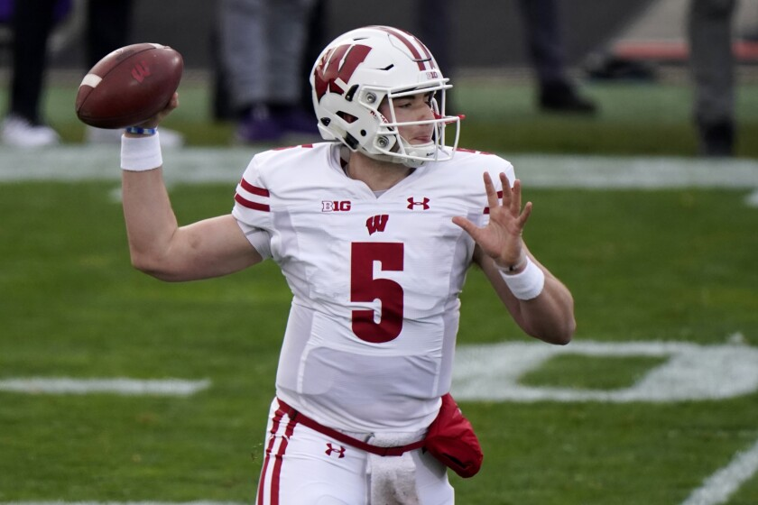 Wisconsin quarterback Graham Mertz throws a pass during the first half of an NCAA college football game against Northwestern in Evanston, Ill., Saturday, Nov. 21, 2020. (AP Photo/Nam Y. Huh)