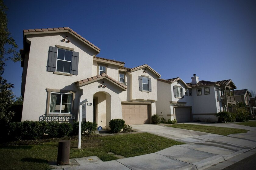 San Diego County home prices were up 0.7 percent in November, said the S&P/Case-Shiller Home Price Index. Pictured are homes in Chula Vista.