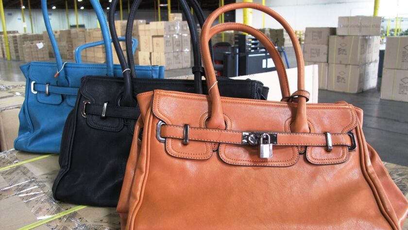"""Shipments of handbags bearing counterfeit """"Hermes"""" trademarks arrived from China at the Los Angeles/Long Beach port complex in 2013 and were seized by authorities."""