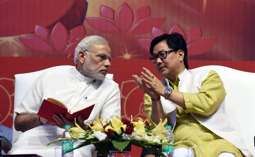 Indian Prime Minister Narendra Modi, left, talks with Junior Home Minister Kiren Rijiju during International Buddha Poornima Diwas celebrations in New Delhi on May 4. A flight was held for Rijiju on June 24, inconveniencing passengers and causing controversy.