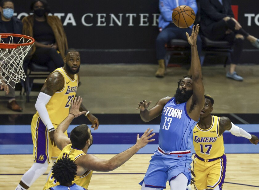 Houston Rockets guard James Harden (13) passes the ball against the Los Angeles Lakers during the third quarter of an NBA basketball game Tuesday, Jan. 21, 2021, in Houston. (Troy Taormina/Pool Photo via AP)