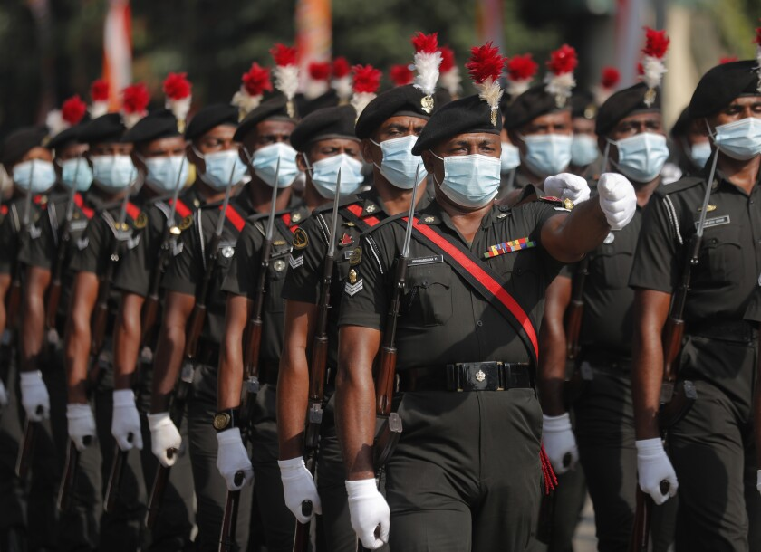 Sri Lankan army soldiers march during the 73rd Independence Day parade rehearsal in Colombo, Sri Lanka, Wednesday, Feb. 3, 2021. Sri Lanka's independence from British colonial rule is celebrated on Feb. 4 each year. (AP Photo/Eranga Jayawardena)