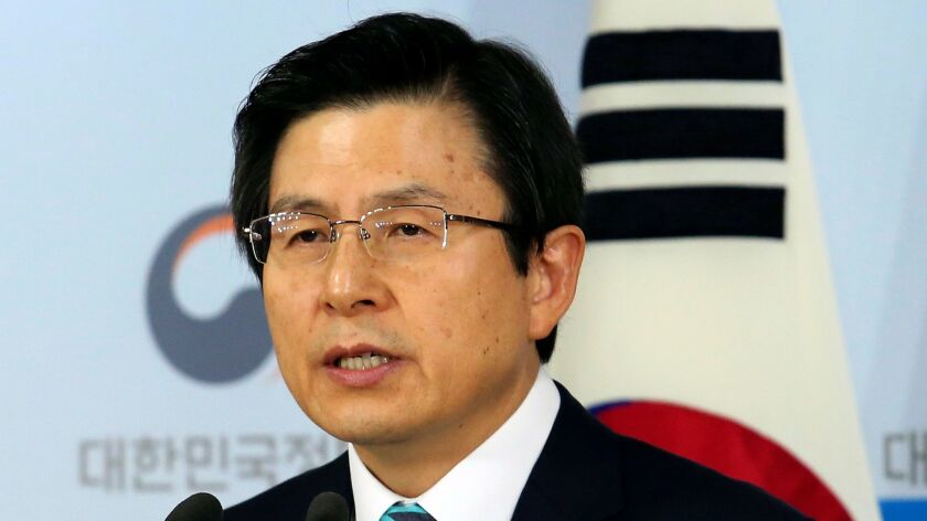 South Korean acting leader Hwang Kyo-ahn speaks during a news conference in Seoul on Jan. 23.