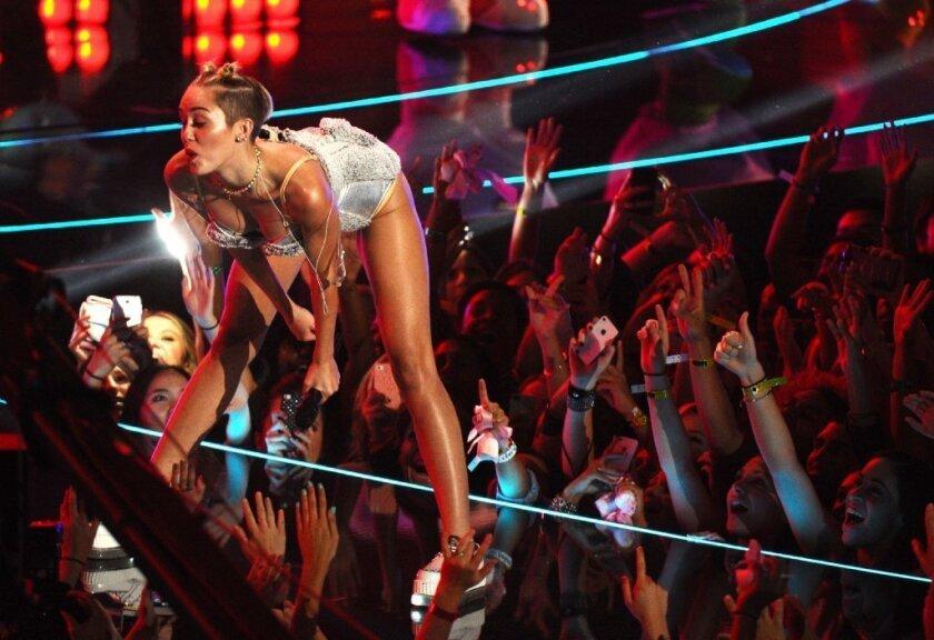 Miley Cyrus twerks at the MTV Video Music Awards on Sunday night.