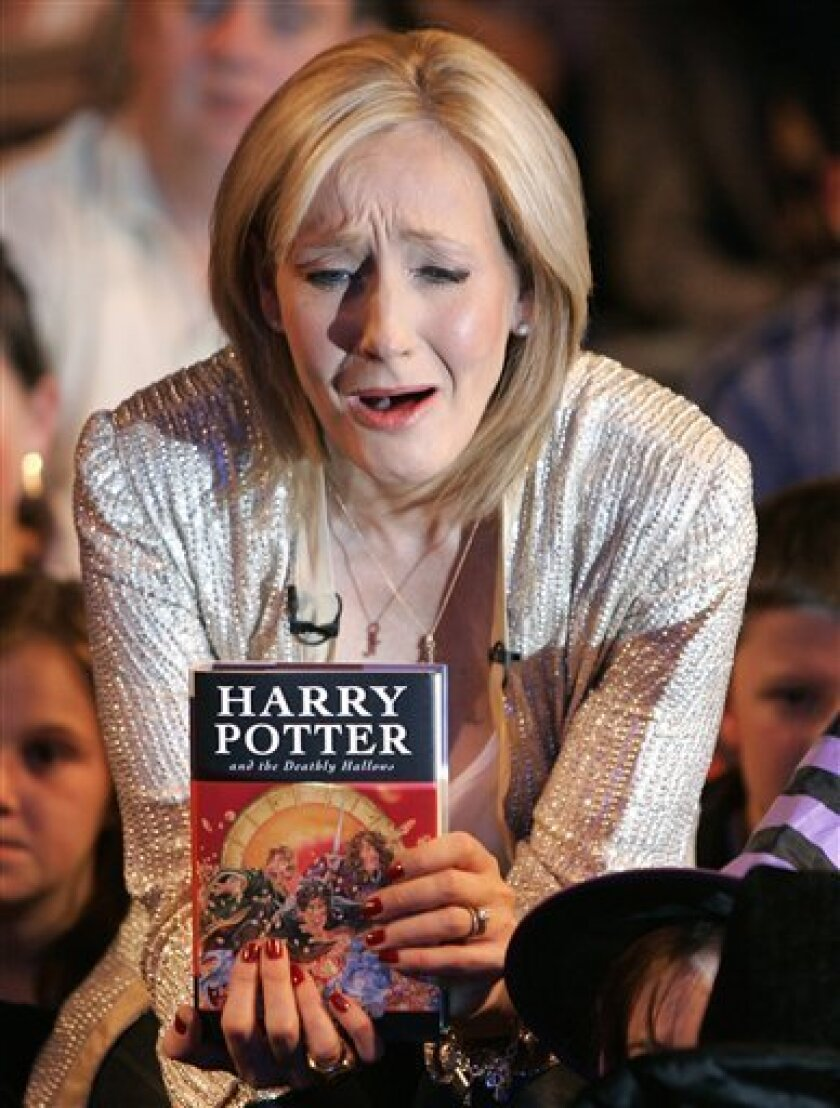 """FILE-In this Friday, July 20, 2007 file picture British author J.K. Rowling reacts during a photocall for the release of her latest Harry Potter book titled """"Harry Potter and the Deathly Hallows"""" at the Natural History Museum in London.Harry Potter fans are holding their collective breath as author J.K. Rowling gets set to reveal her latest project involving the boy wizard. Rowling has called a news conference Thursday in London to reveal details of """"Pottermore,"""" a mysterious website that has been taunting fans with the words """"coming soon."""" (AP Photo/Kirsty Wigglesworth)"""