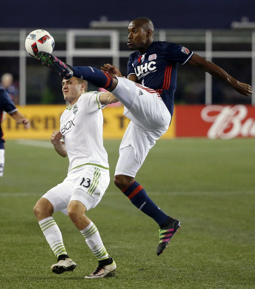 New England Revolution's Jose Goncalves, right, kicks the ball over Seattle Sounders's Jordan Morris (13) during the second half of an MLS soccer game Saturday, May 28, 2016, in Foxborough, Mass. The Revolution won 2-1. (AP Photo/Michael Dwyer)