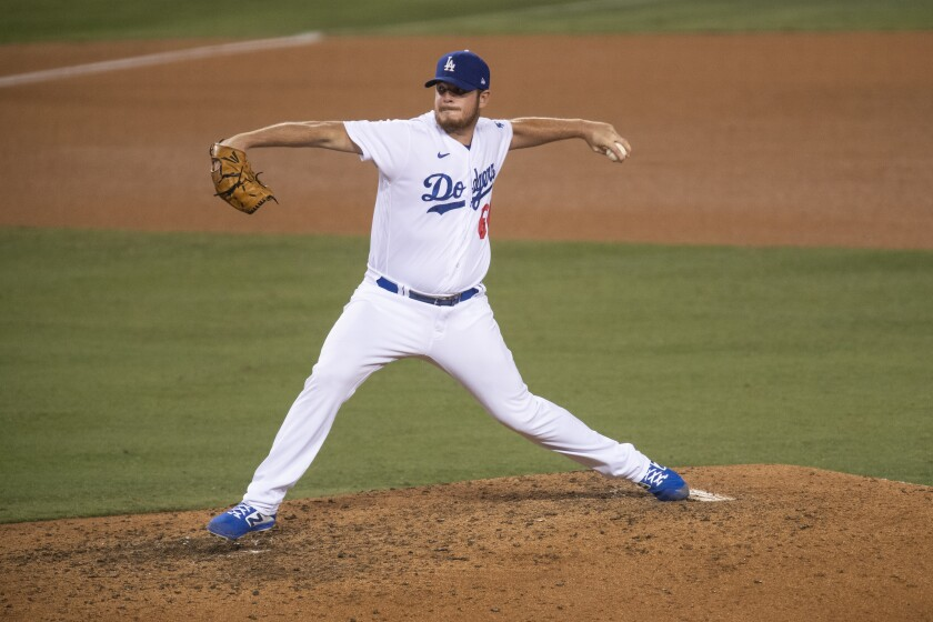Dodgers relief pitcher Caleb Ferguson delivers during a game.
