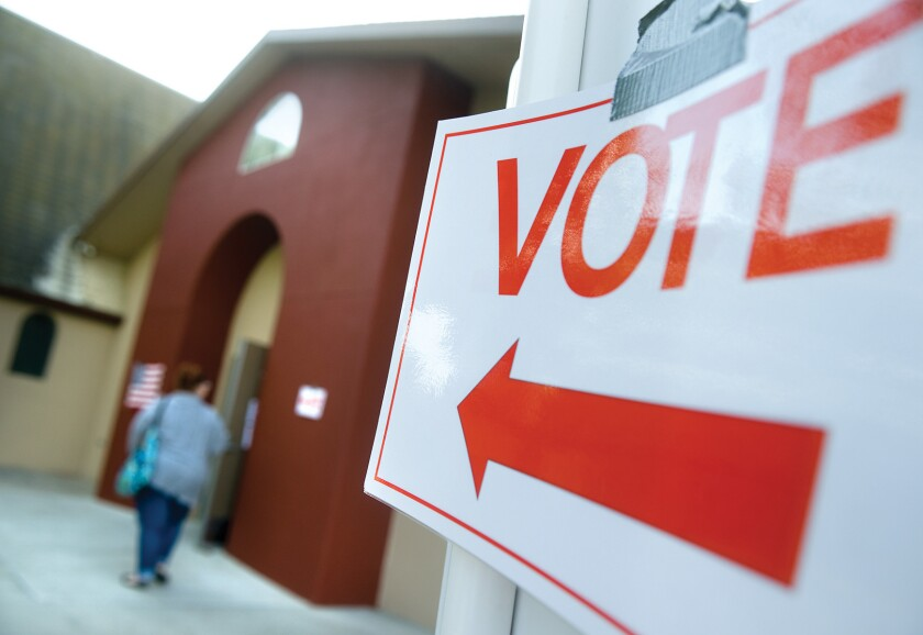 A sign points to a polling station at the First Baptist Church in Porterville on Nov. 4.