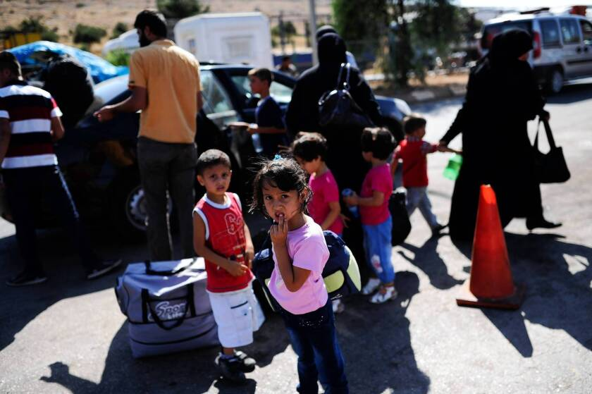 """Syrian refugees arrive in Reyhanli, Turkey. In Syria, rebels say they feel let down by the delay in U.S. strikes. """"The Syrian people were very hopeful,"""" one militia leader says."""
