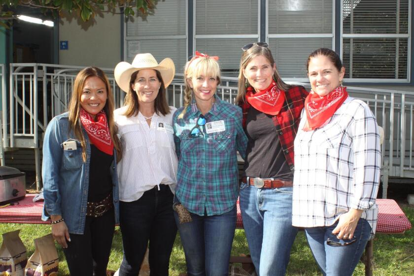 Jenny Hochberg, Micaela Jeffrey, Kimberly Buffington, Kat Peppers and Margot Ponticello volunteer at Muirlands Middle School's Western BBQ on Dec. 20, 2018.