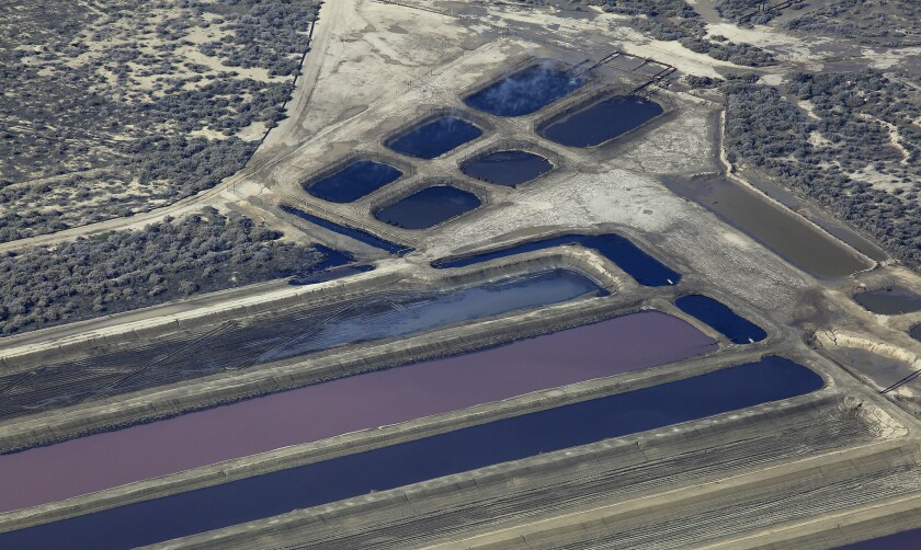 Aerial view of pits containing production water from oil wells near Hwy. 33 and Lokern Road in Kern County.