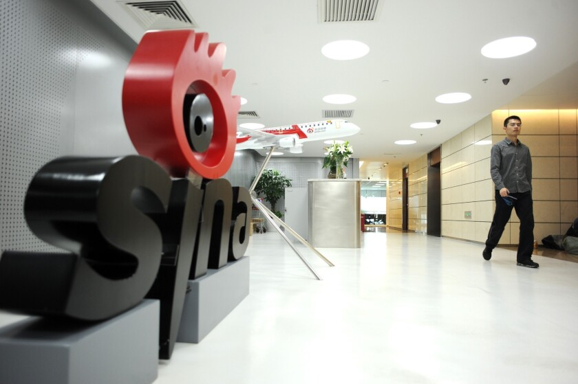 A man walks past the office entrance of Sina Weibo, widely known as China's version of Twitter, in Beijing.