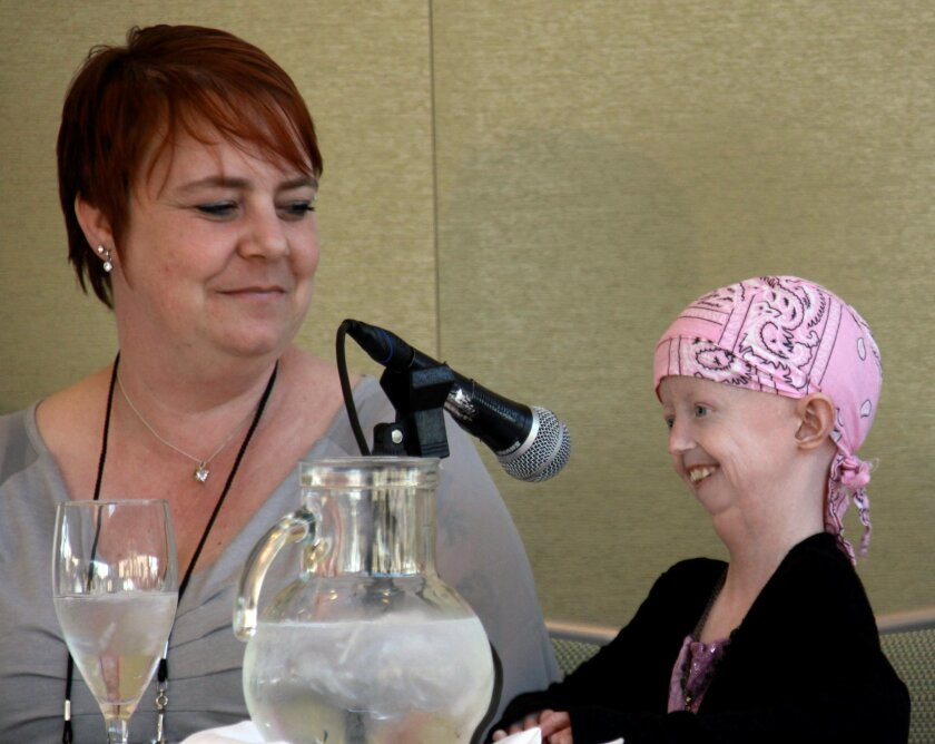 In this photo provided by the Progeria Research Foundation on Friday, April 3, 2015, Hayley Okines, right, talks during an interview with her mother Kerry. A campaigner who raised awareness of the rare genetic condition progeria, which causes those affected to age some eight times faster than average, has died at age 17. The U.S.-based Progeria Research Foundation said Hayley Okines, from East Sussex in England, died Thursday, April 2, 2015, at her home. It did not provide more details. (AP Photo/Progeria Research Foundation)