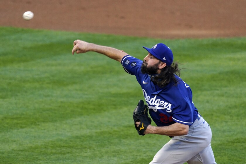 Los Angeles Dodgers starting pitcher Tony Gonsolin throws to the plate during the first inning of a spring training exhibition baseball game against the Los Angeles Angels Sunday, March 28, 2021, in Anaheim, Calif. (AP Photo/Mark J. Terrill)