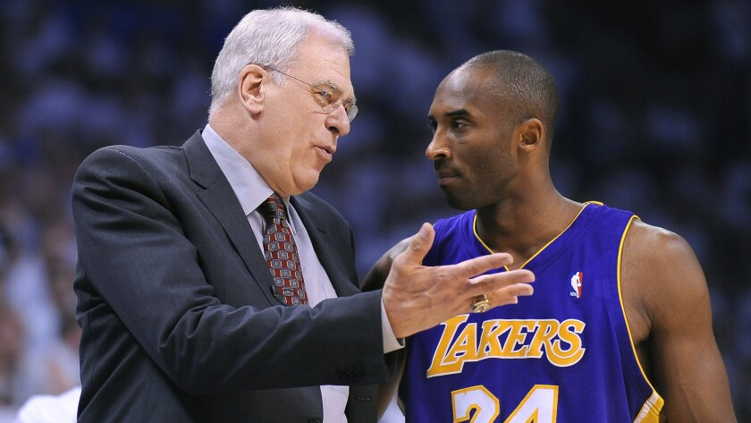 Lakers star Kobe Bryant, right, speaks with coach Phil Jackson in 2010.