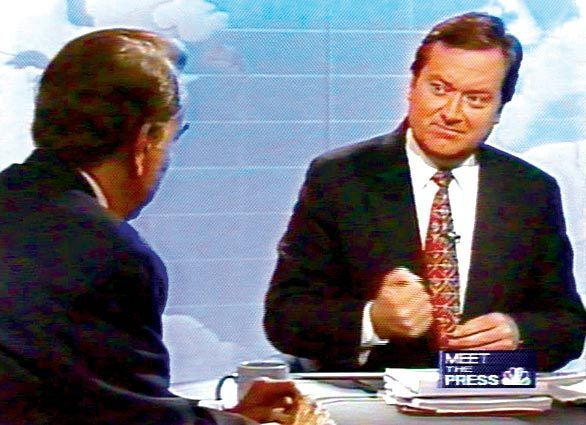 """Tim Russert speaks with Sen. Bob Dole on """"Meet the Press"""" in a 1996 interview. Russert joined the program as host in 1991."""