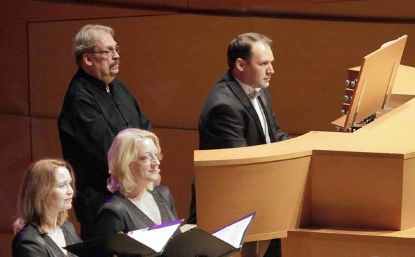 """Organist Paul Meier, right, performs Arvo Part's """"The Beatitudes"""" with the Los Angeles Master Chorale."""