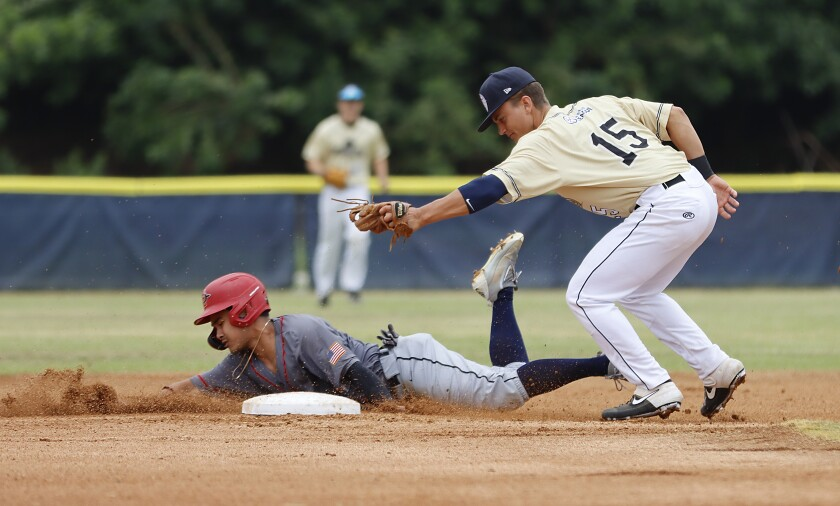 Warriors' Matt Rudick is out at second base after being tagged by Brewers shortstop Quinn Hoffman in game Monday.